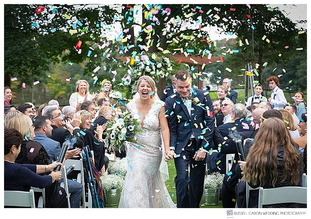 bride and groom during confetti cannon recessional
