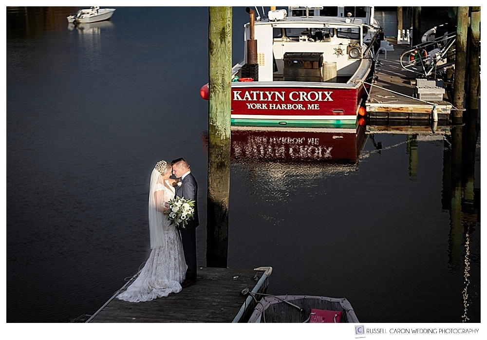bride and groom standing on a dock in southern Maine