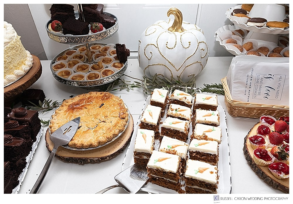 dessert bar with pies and cakes