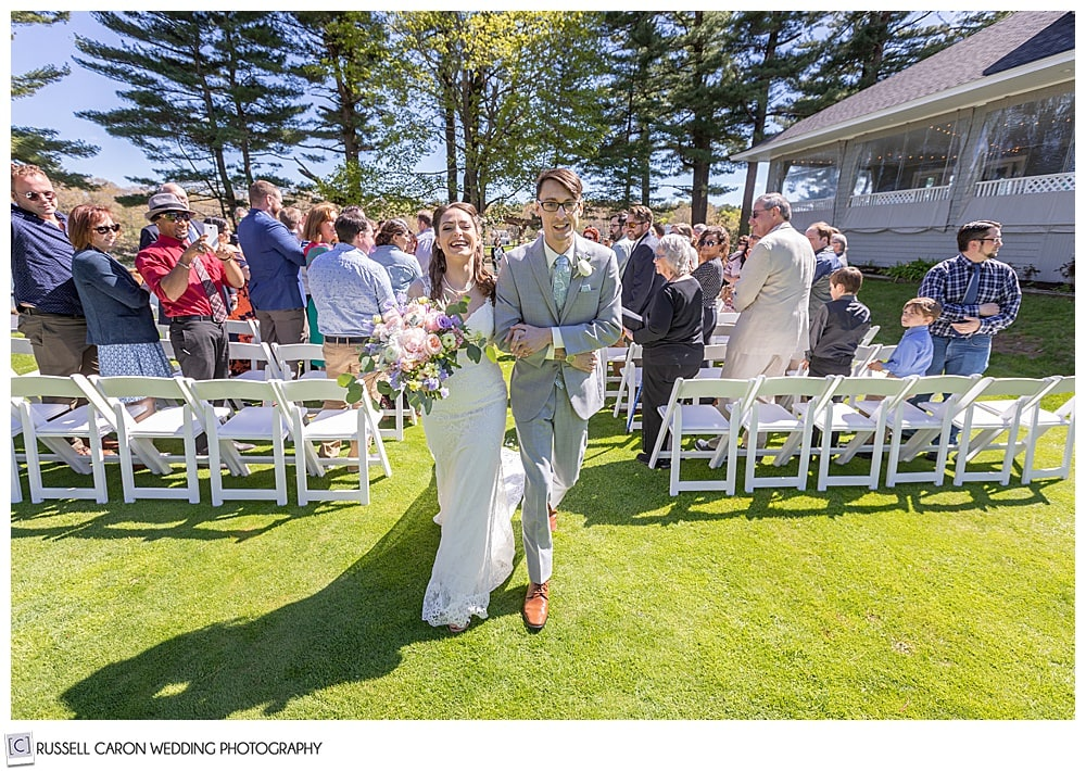 bride and groom during their recessional at the York Golf and Tennis Club, York Maine wedding