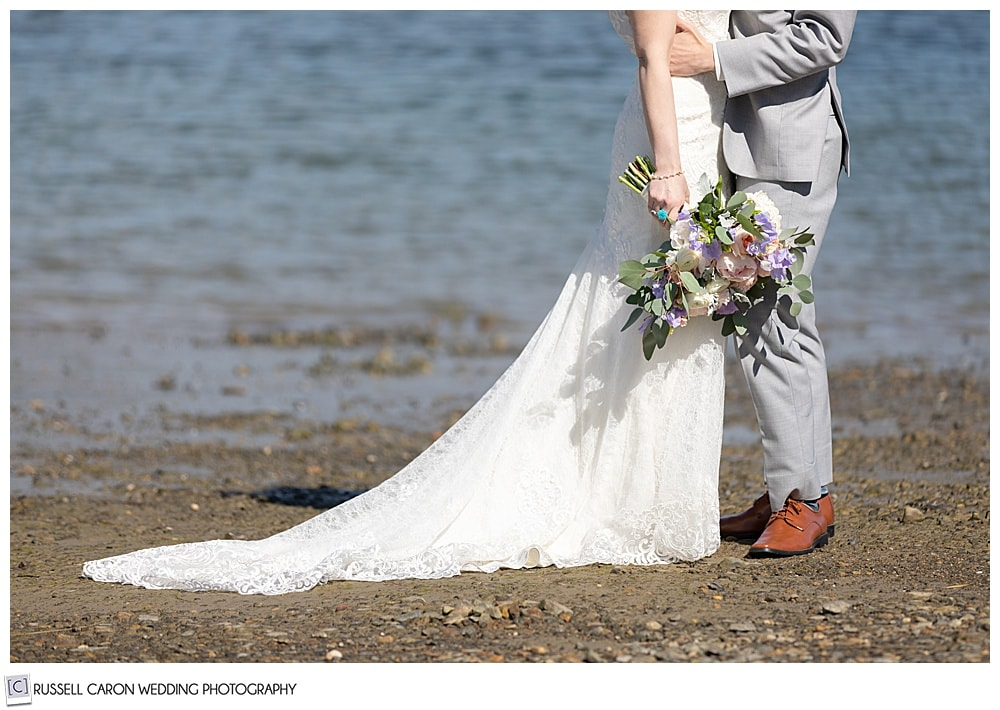 bride and groom at the water's edge