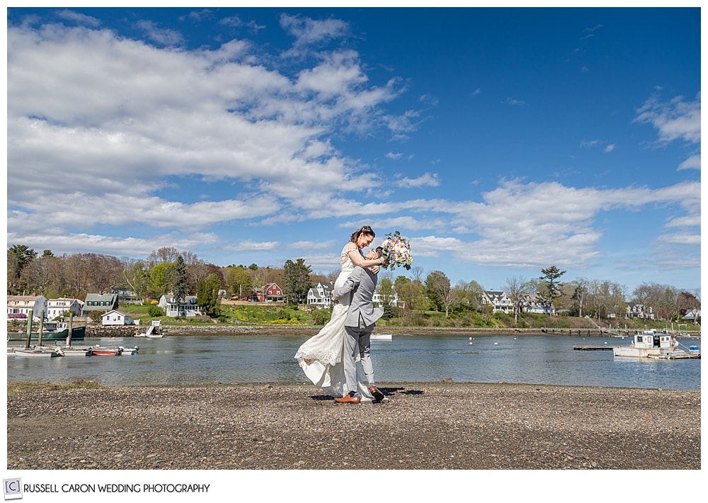 groom picking up his bride on the York River, York, Maine