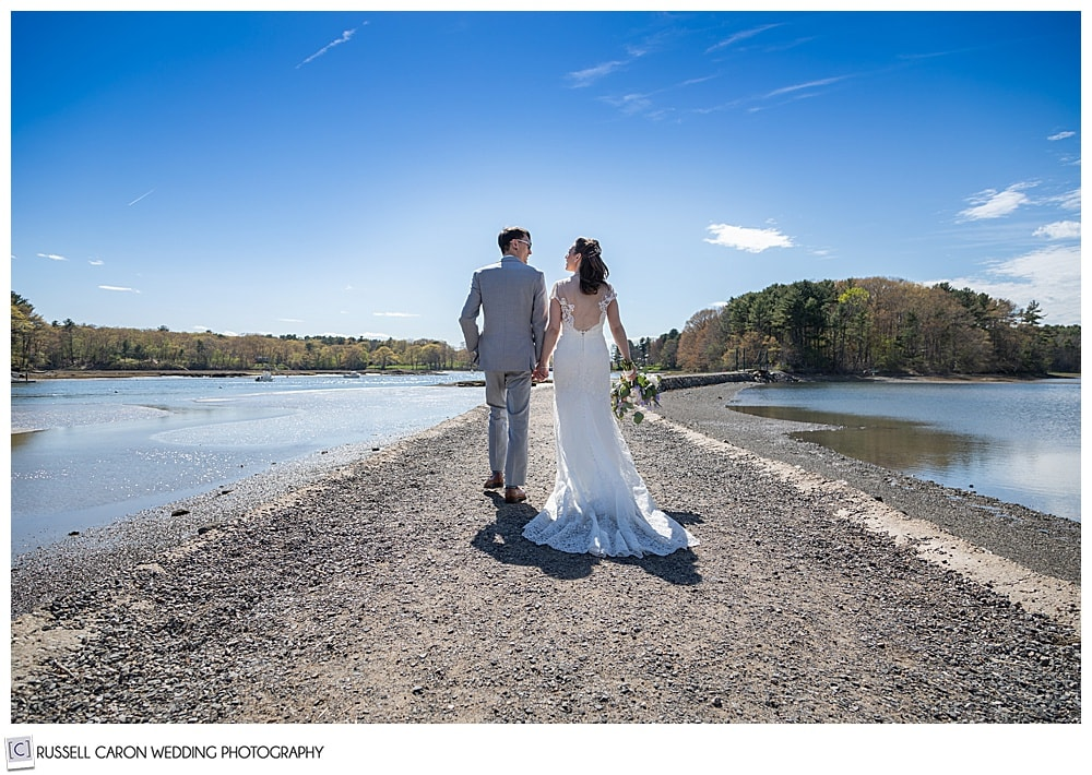 Bride and groom walking on the path to the Wiggley Bridge, York, Maine