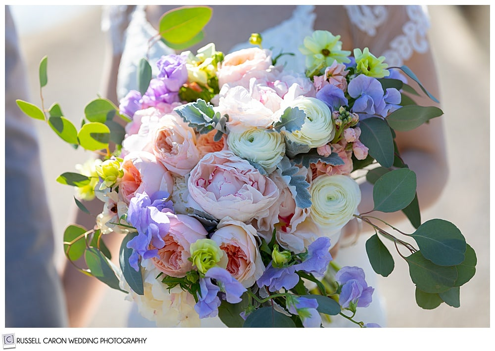 beautiful bridal bouquet with sweet pea, ranunculus, and eucalyptus