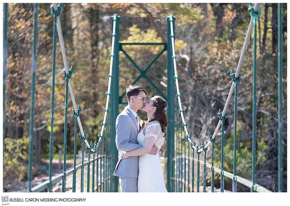 bride and groom kissing on the Wiggley Bridge, York, Maine