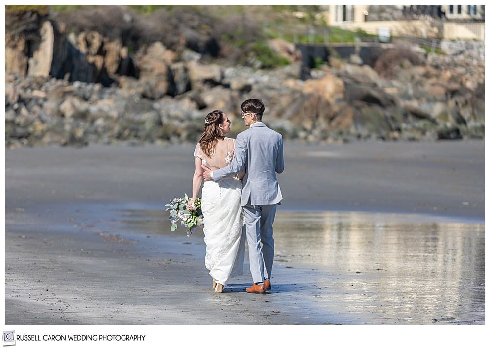 bride and groom walking on York Harbor Beach, York Harbor, Maine