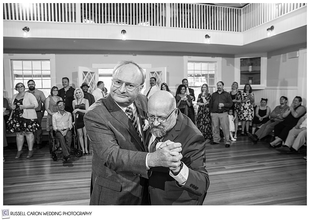 black and white photo of two men dancing