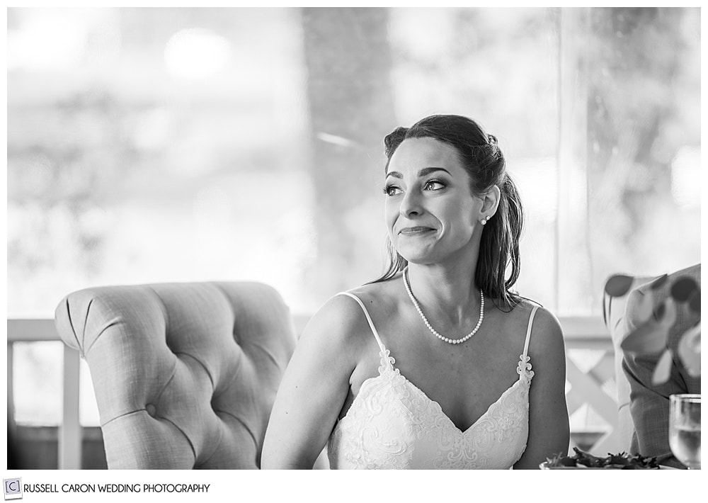 black and white photo of bride smiling