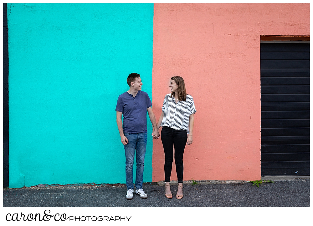 man and woman standing in front of a colorful wall in Southern, Maine, Southern Maine wedding photographers