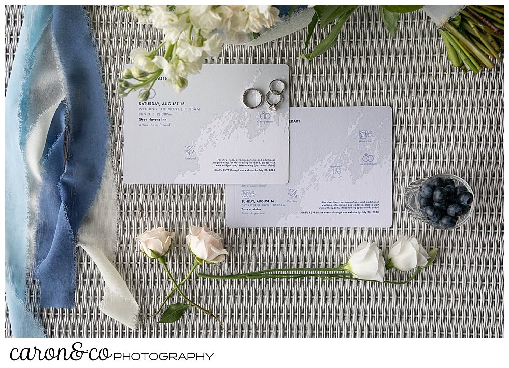 wedding day details with bouquet, paper suite, and rings