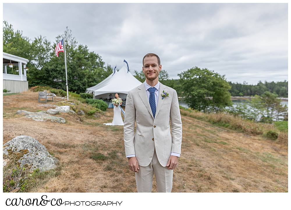 groom with his back turned, waiting for the wedding day first look at Grey Havens Inn wedding, Georgetown Maine