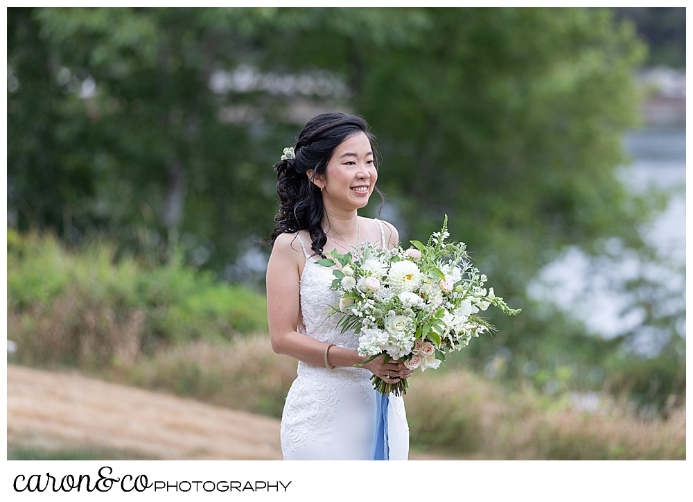 bride smiling during wedding day first look at Grey Havens Inn wedding, Georgetown Maine
