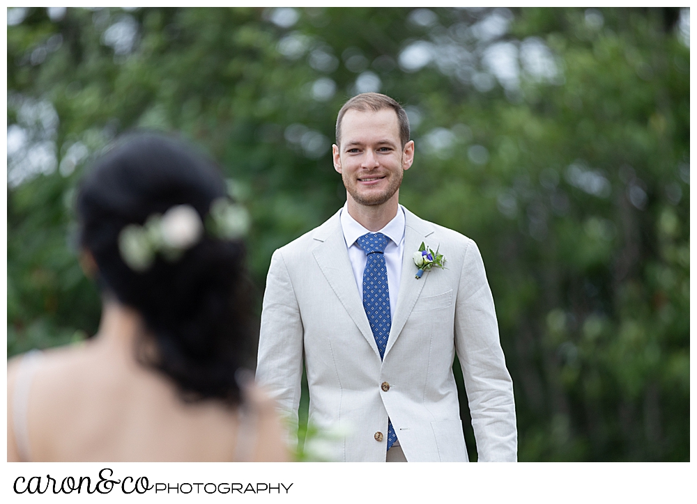 groom walking towards bride during wedding day first look at Grey Havens Inn wedding, Georgetown Maine