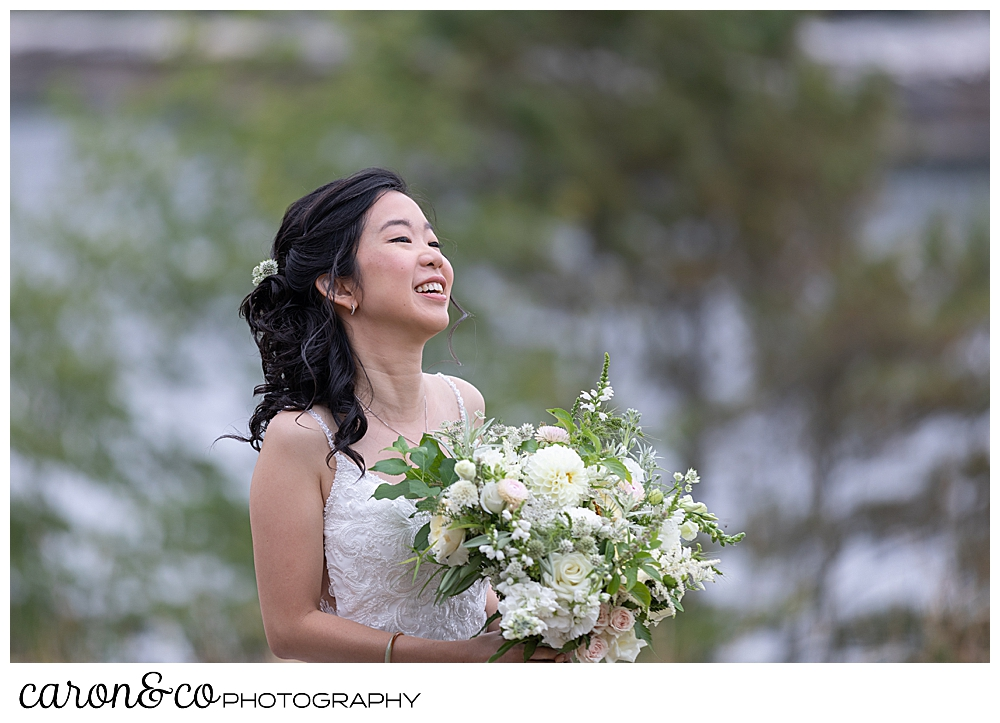 smiling bride during wedding day first look at Grey Havens Inn wedding, Georgetown Maine