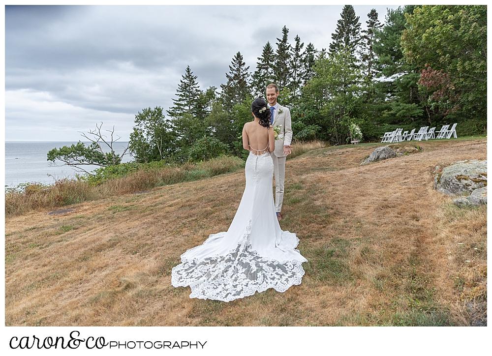brides wedding gown detail during wedding day first look at a Grey Havens Inn wedding, Georgetown Maine