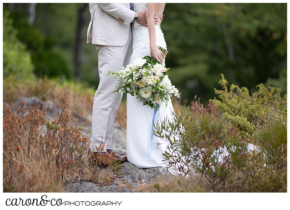 bride and groom together, with a white, green, yellow, and pink Bad Rabbit Flowers bouquet at a Grey Havens Inn wedding, Georgetown Maine