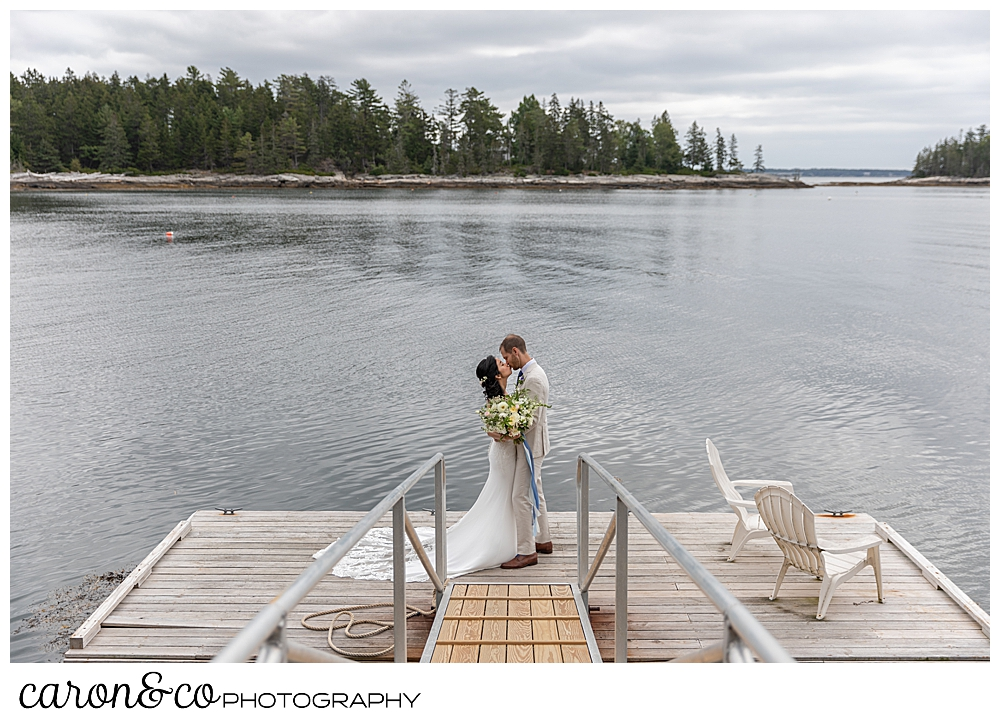 bride and groom kissing on a dock at Grey Havens Inn wedding, Georgetown Maine