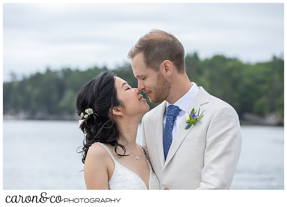 bride and groom kissing at a Grey Havens Inn wedding, Georgetown Maine