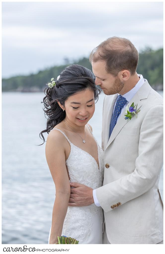 bride and groom standing together during a coastal Maine Grey Havens Inn wedding