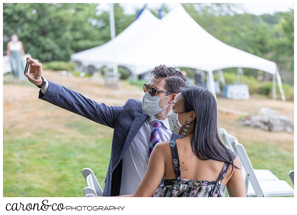 wedding guests taking a selfie, with masks on, before a Grey Havens Inn wedding ceremony, Georgetown Maine