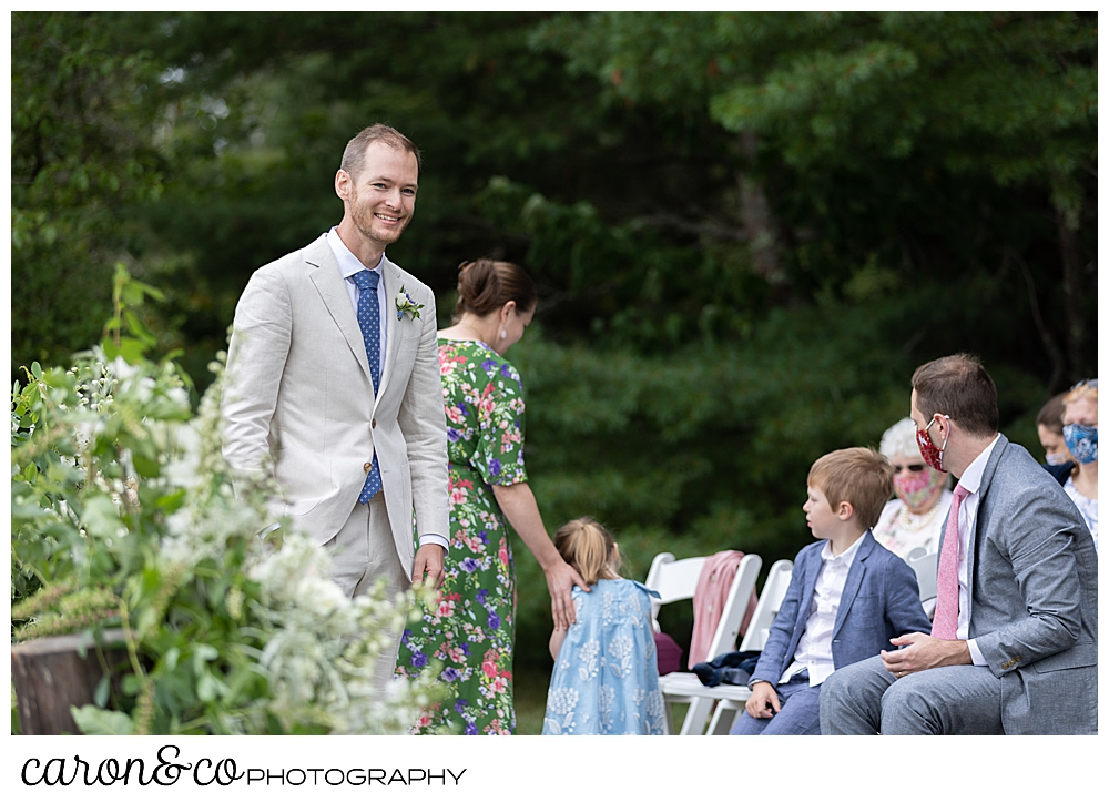 groom waits for his bride during a Grey Havens Inn wedding ceremony, Georgetown Maine