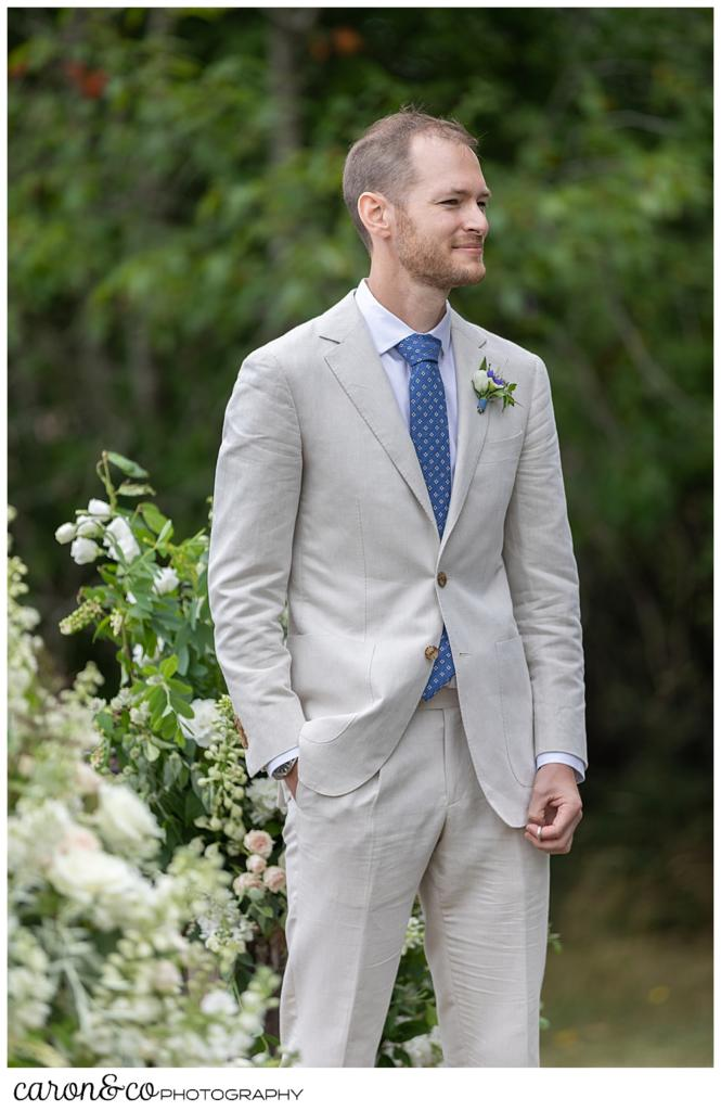 Groom watches as his bride walks down the aisle at a Grey Havens Inn wedding ceremony, Georgetown Maine