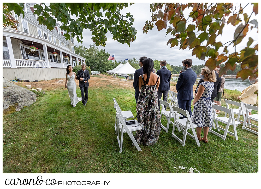 bride approaching the aisle at an outdoor Grey Havens Inn wedding ceremony, Georgetown Maine