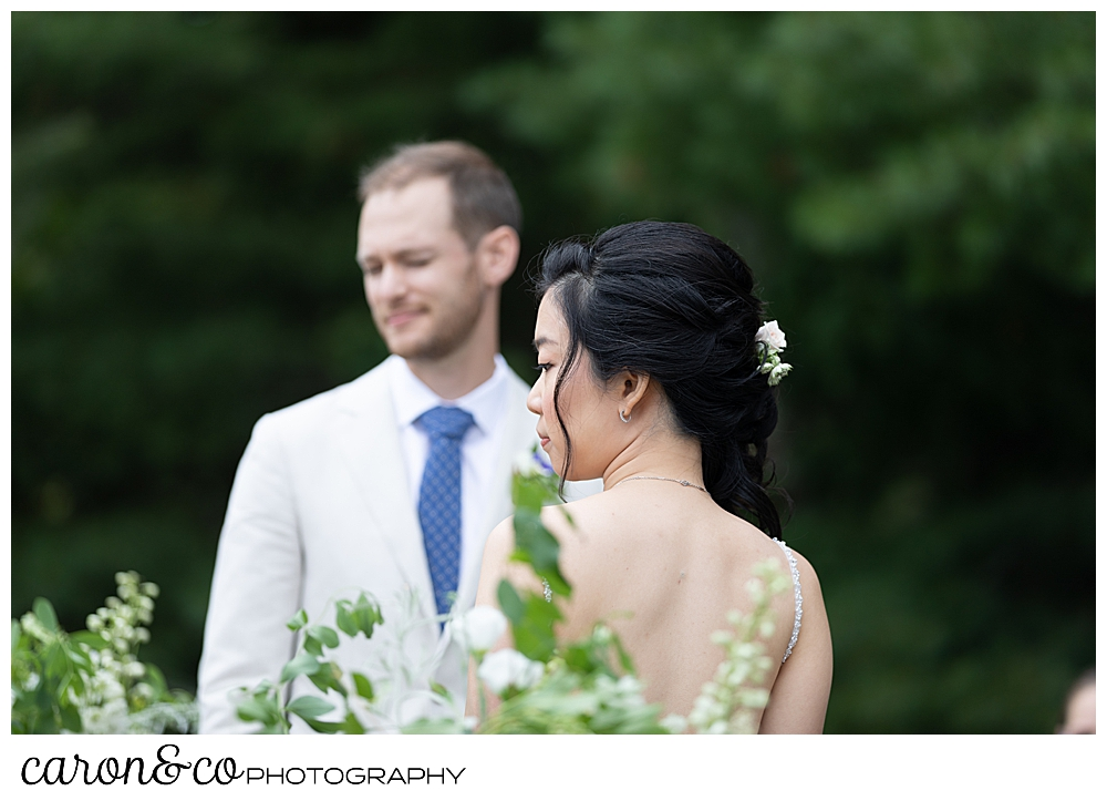 bride and groom during a Grey havens Inn wedding ceremony on the lawn, Georgetown Maine