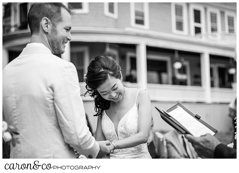 black and white photo of a bride laughing during her Grey Havens Inn wedding, Georgetown Maine