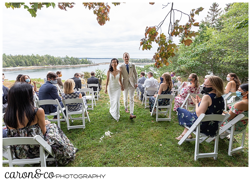 bride and groom during recessional at their Grey Havens Inn wedding, Georgetown Maine