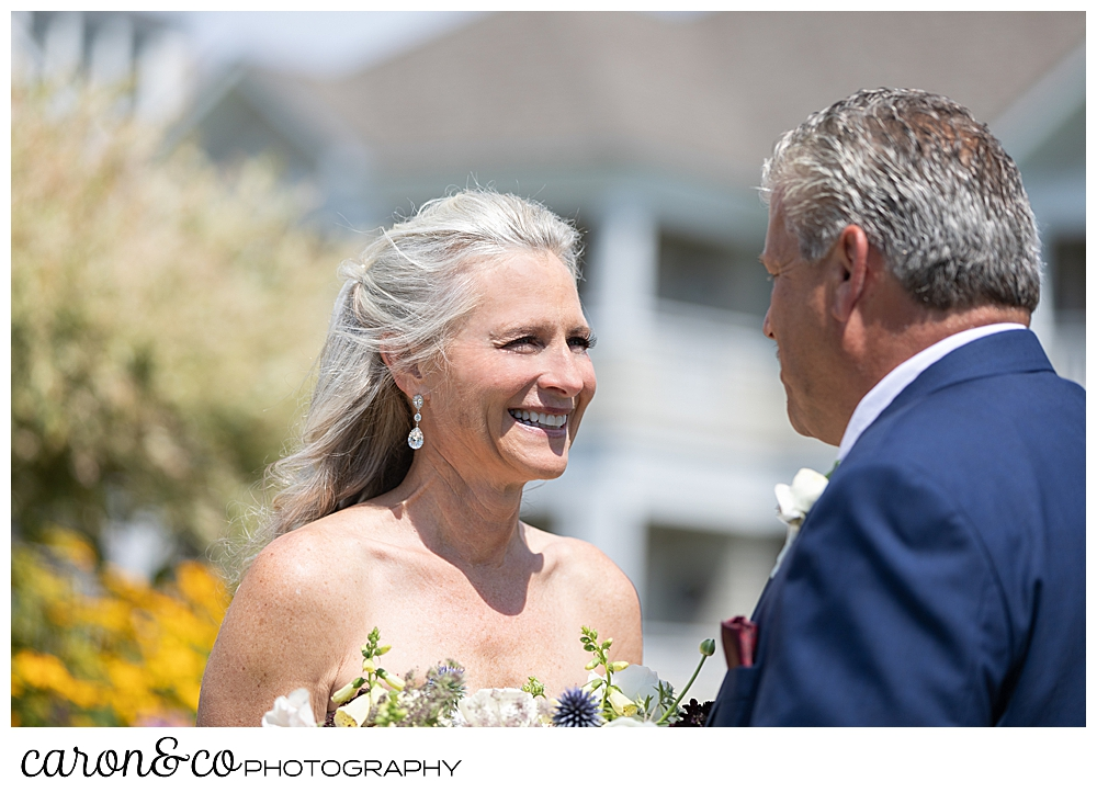 bride smiles at her groom during their first look