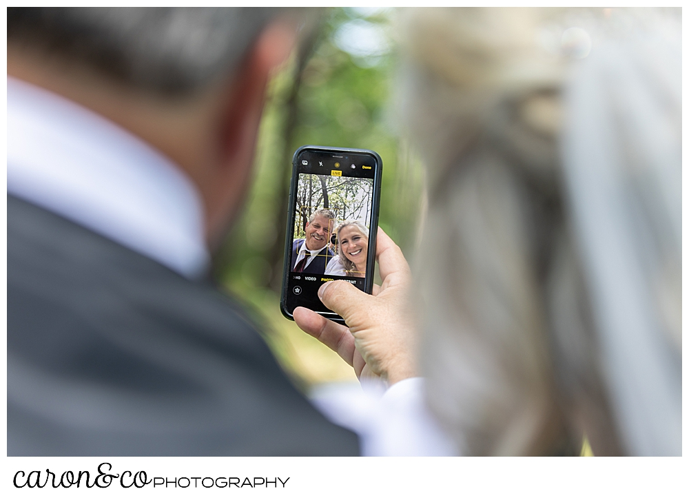 bride and groom take a selfie