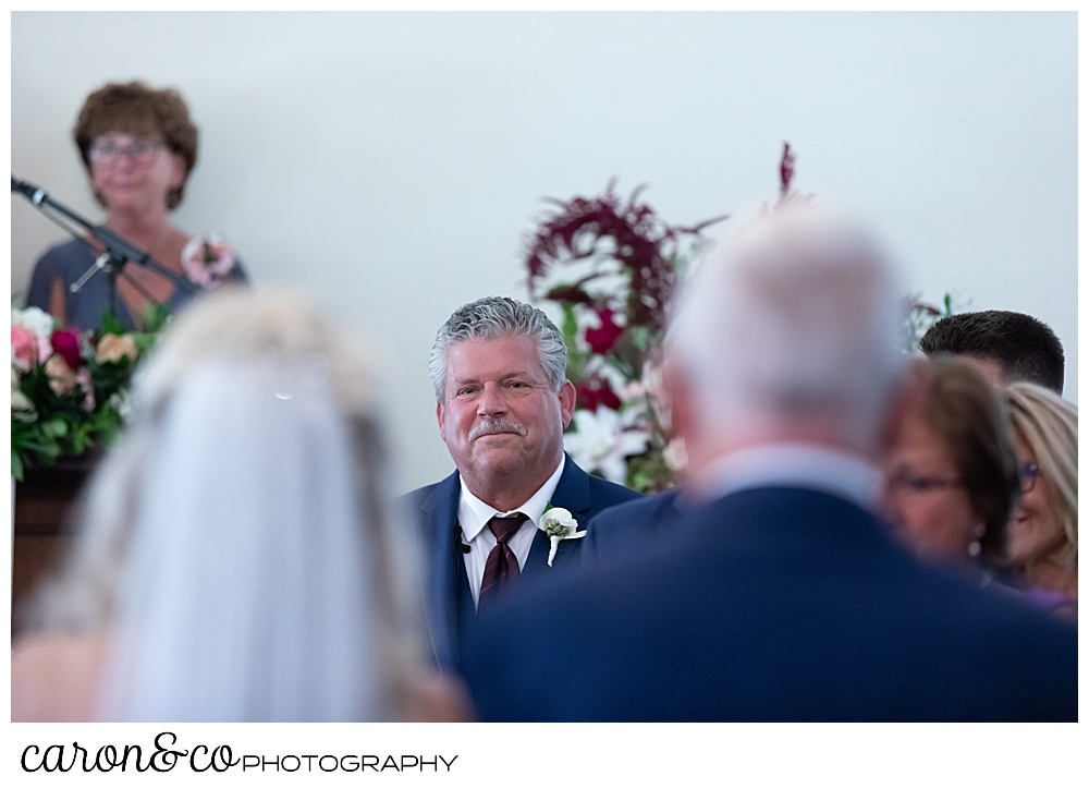 groom seeing his bride approach during their spurwink church cape elizabeth maine wedding ceremony