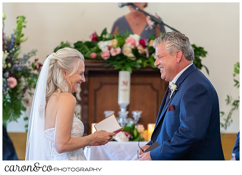 bride and groom laughing during their spurwink church cape elizabeth maine wedding ceremony
