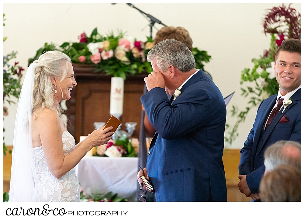 groom wipes his eye during his spurwink church cape elizabeth maine wedding ceremony