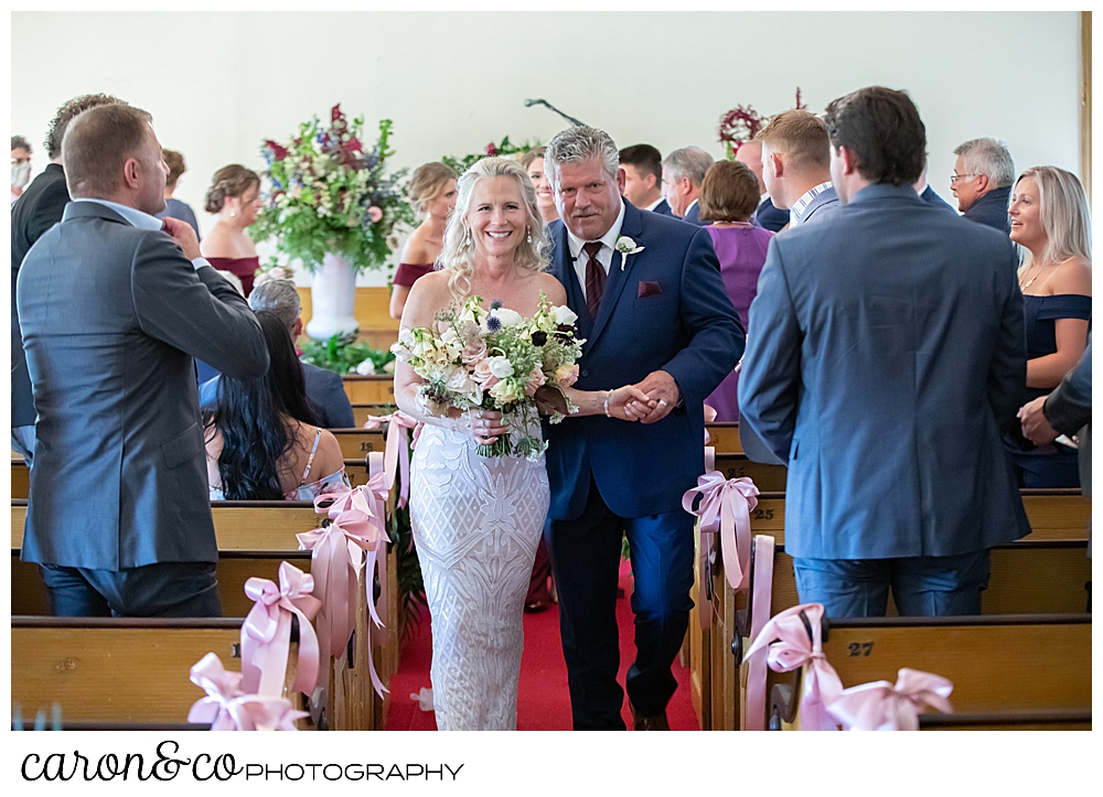 bride and groom during the recessional at the spurwink church cape elizabeth maine wedding ceremony