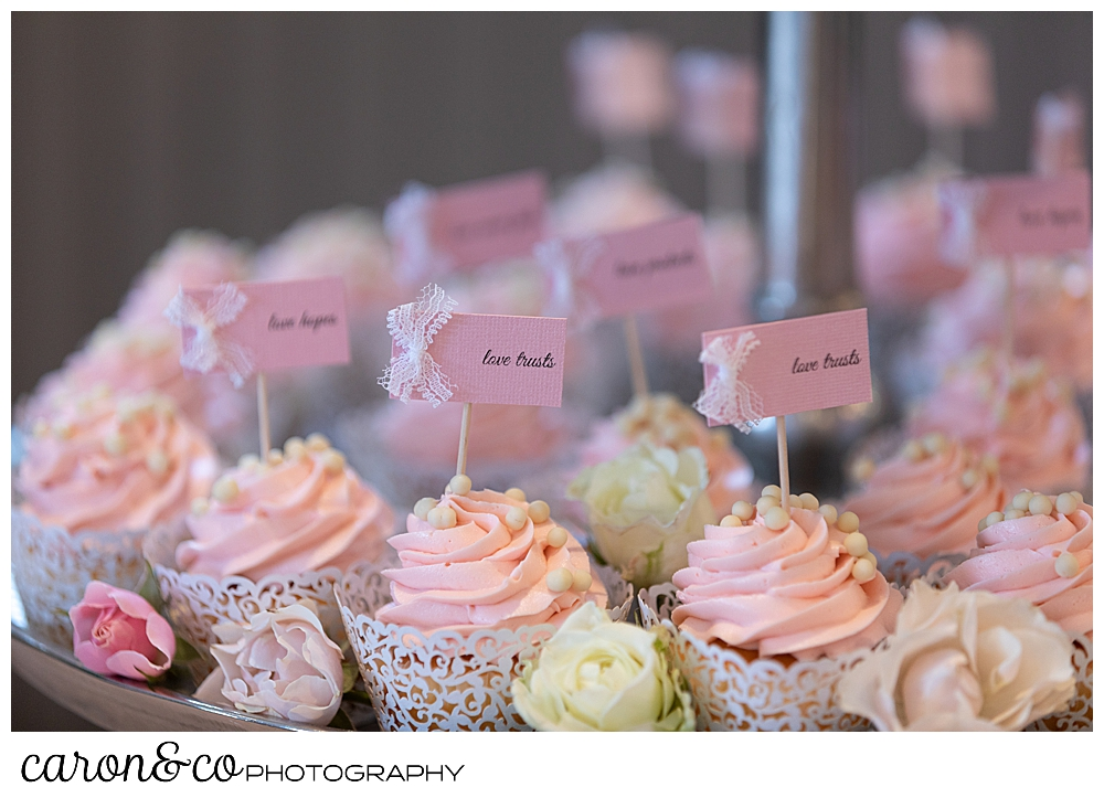 pink and white cupcakes at a scarborough maine wedding reception