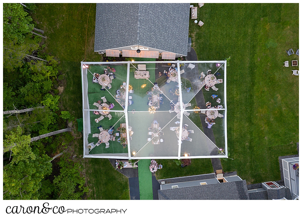 maine drone wedding photo of a backyard reception with a clear tent in a Scarborough Maine wedding