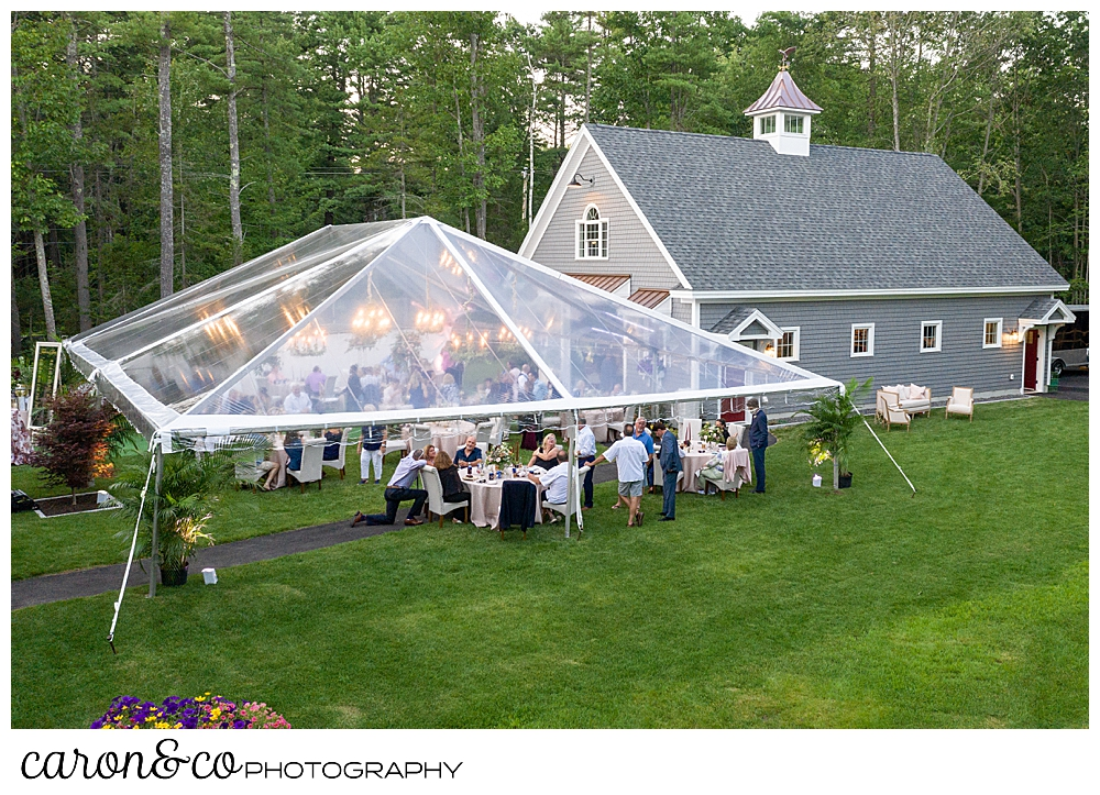 Maine drone wedding photo of a backyard wedding, with a clear tent in Scarborough Maine wedding reception