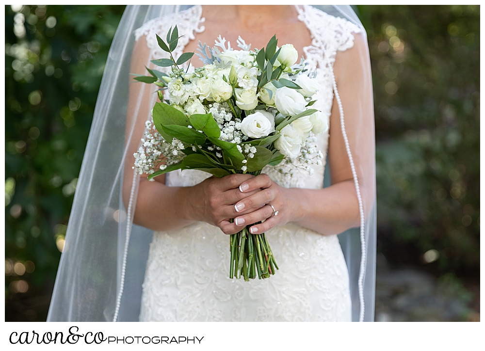 sweet summertime wedding bride holding green and white bridal bouquet