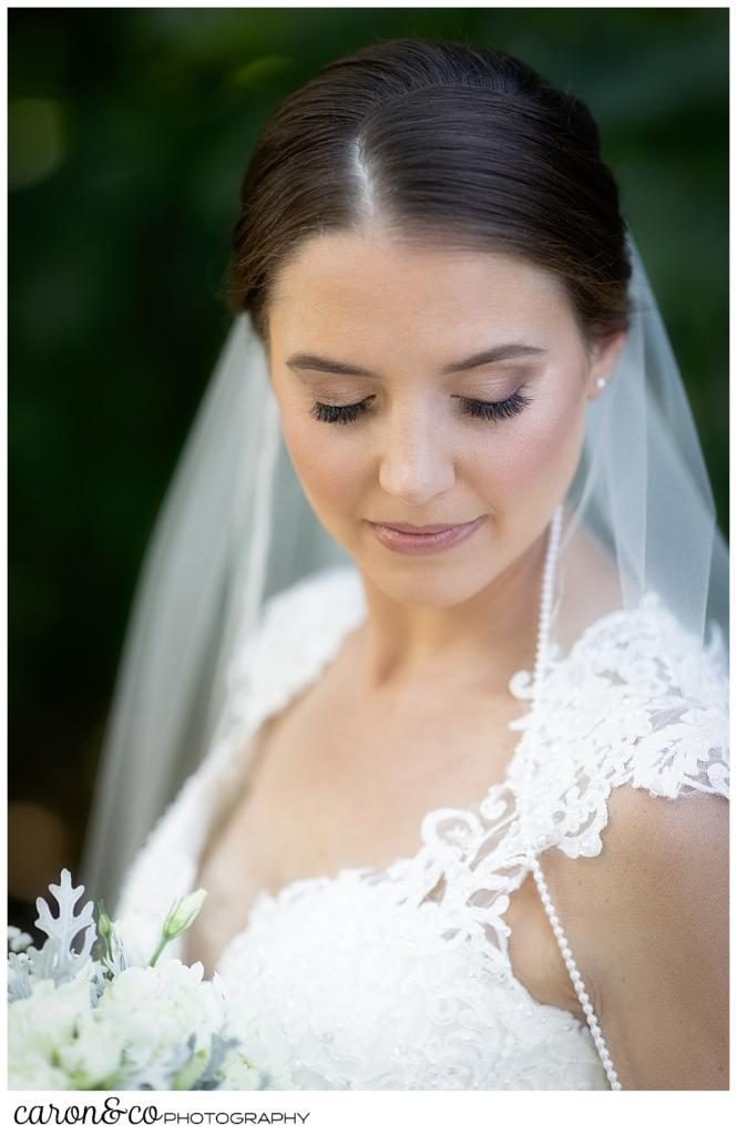 beautiful bridal portrait of a bride in a lacy wedding dress with a veil, with her eyes closed