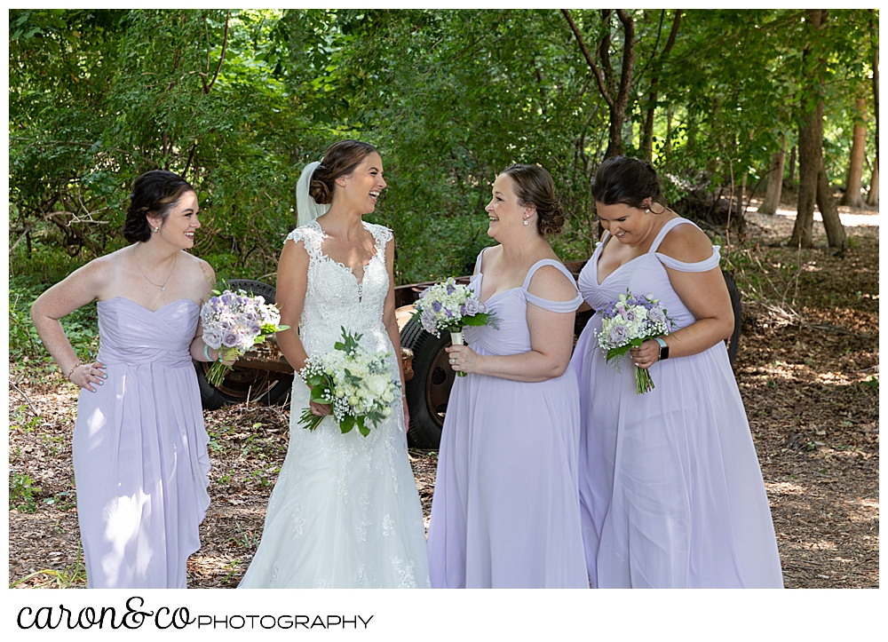 sweet summertime wedding photo of bride and bridesmaids laughing together