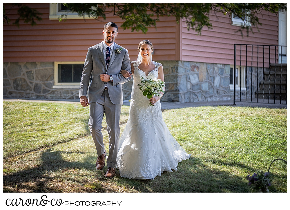 sweet summertime wedding processional with the bride and her brother