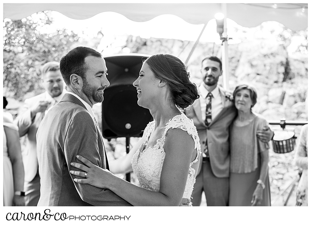 sweet summertime wedding reception, black and white photo of the bride and groom dancing