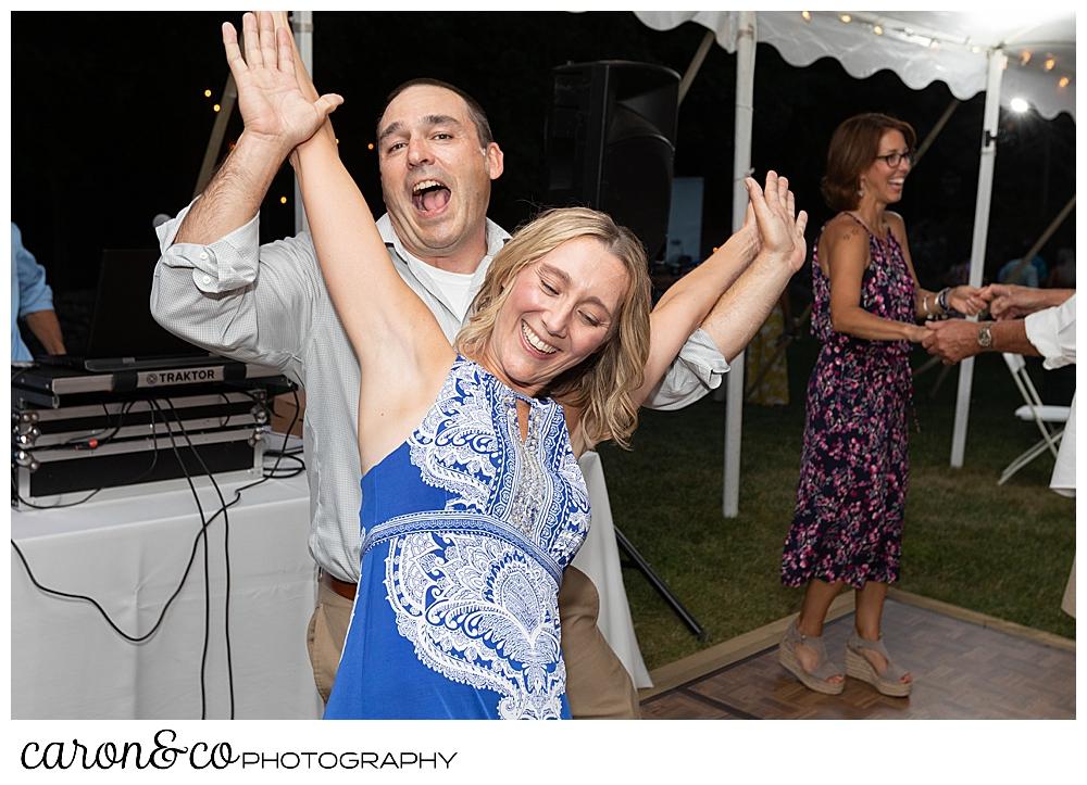 sweet summertime wedding reception photo of guests dancing
