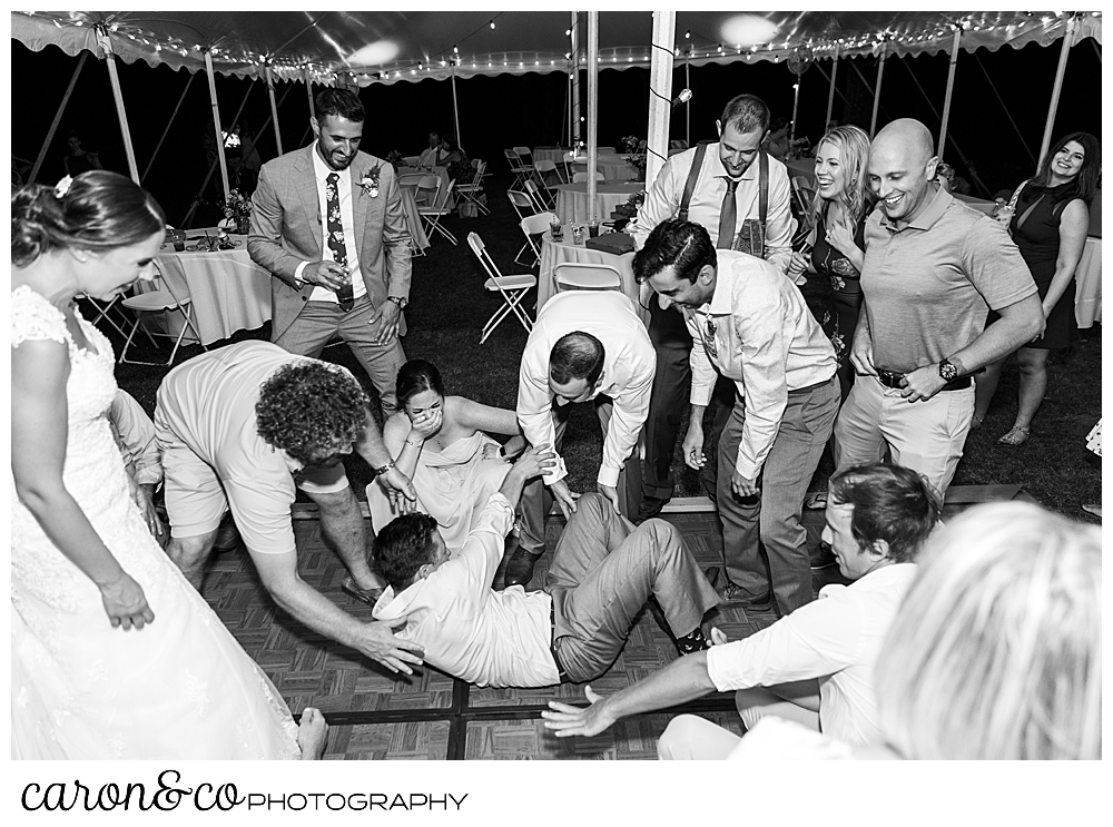 sweet summertime wedding reception black and white photo of guests dancing