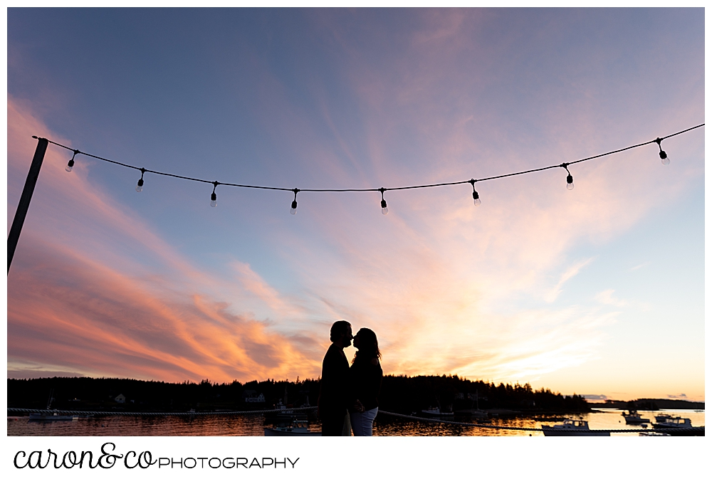 a silhouette of a man and woman kissing during sunset at their Port Clyde Maine engagement photos