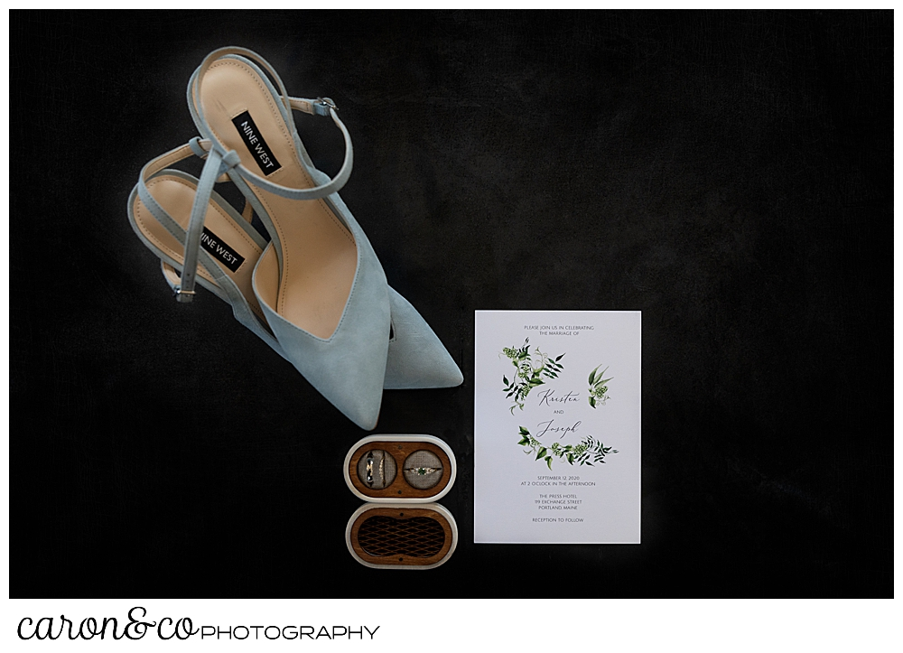 wedding day details, bride's shoes, wedding rings, and invitation at a Portland Press Hotel wedding in Portland Maine
