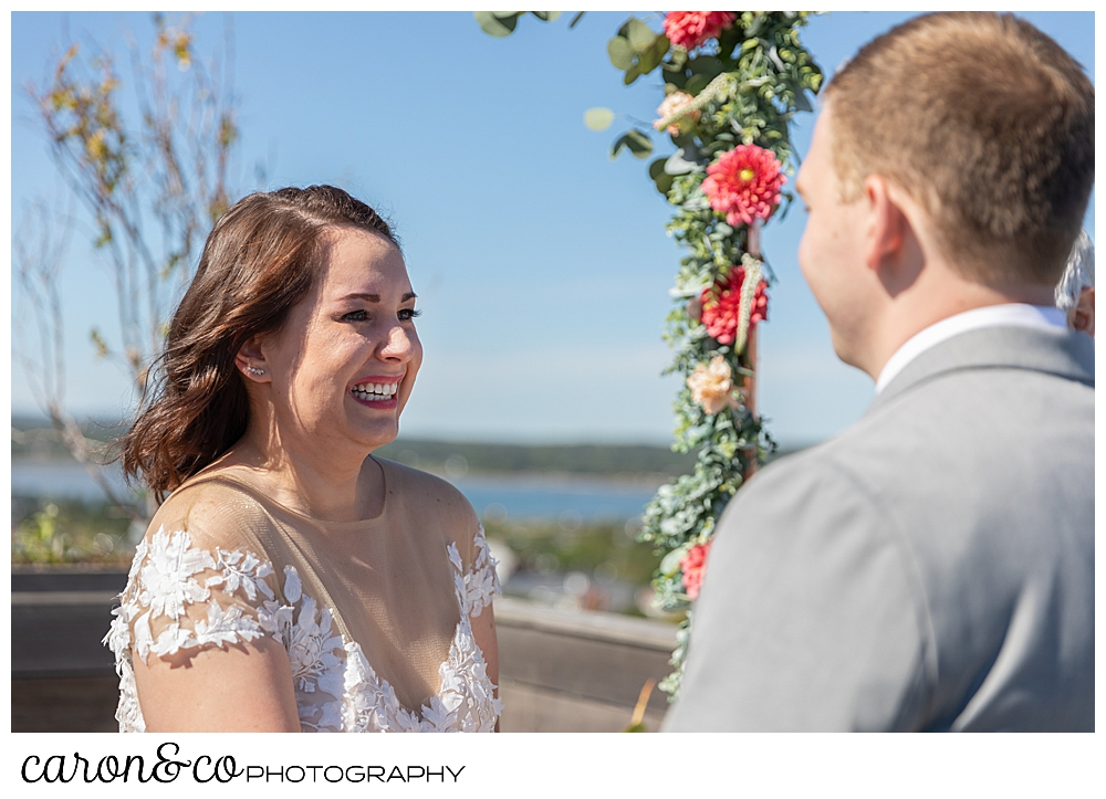 a bride smiles at her groom at a Portland Press Hotel wedding ceremony