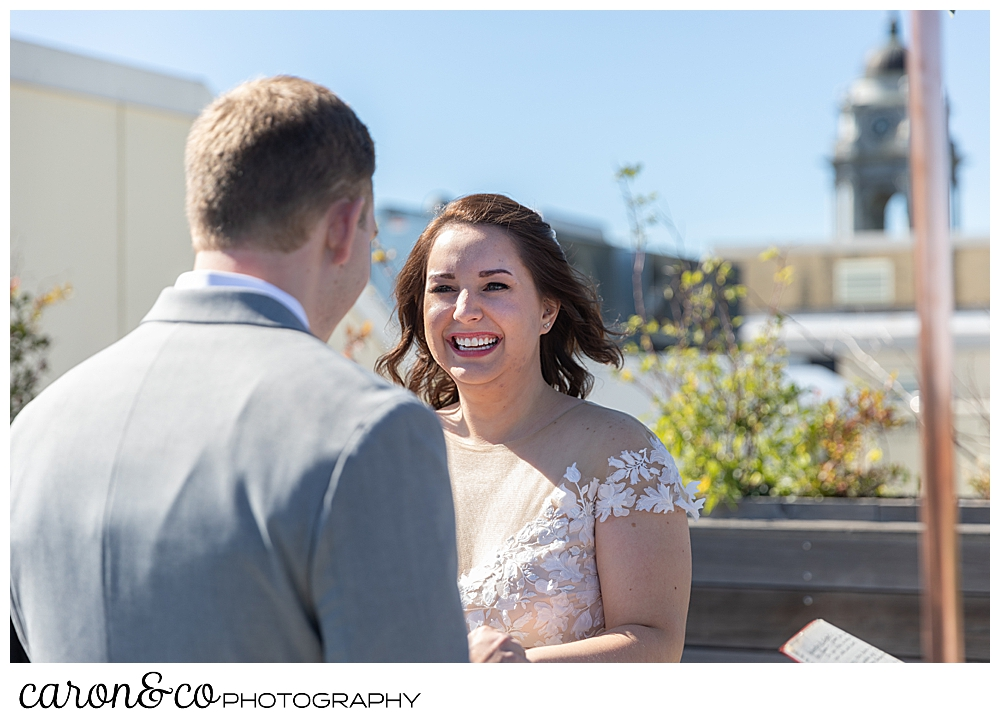 bride smiles at her groom on the rooftop at a Portland Press Hotel wedding